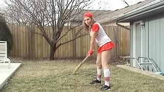 A naughty girl in a very sexy, scandalous softball uniform